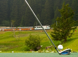 practice range with mountain railway