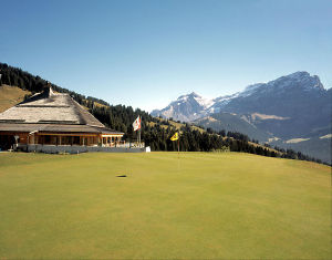 villars golf course with mountain backdrop green