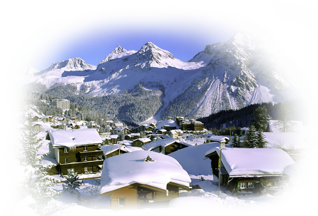 Arosa Winter Ski Holidays - Snowy Village and Alps with blue sky