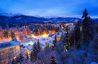 crans montana at night lit up by oliver maire